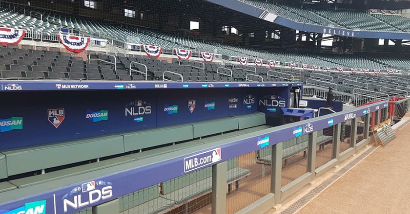 The Doosan logo featured inside the stadium dugout during the <i>NLDS®</i>